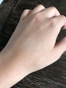 Youth FX Concealer by Revlon blended into the back of a hand