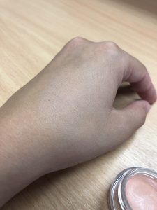 Dark Circle Concealer rubbed into the back of a hand