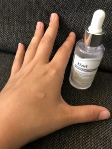 Klairs Vitamin Drop serum dropped on the back of a hand