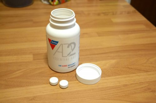 A bottle of Essential AD2 for ALDH2 deficiency sits on a table